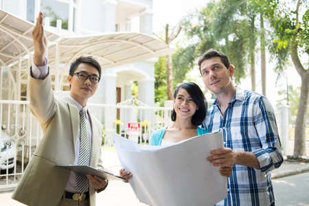 Real-estate broker showing house to a young family