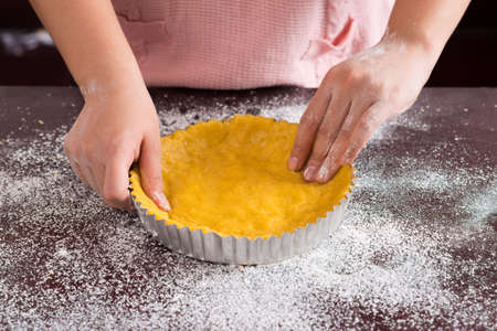 boulangerie: Cropped image of a professional baker?s hands preparing pie at home
