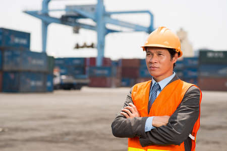 superintendent: Copy-spaced image of a confident worker controlling seaport