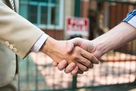 Agent and customer shaking hands