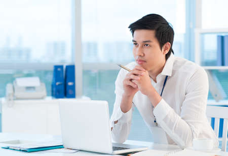 Copy-spaced image of a pensive office worker