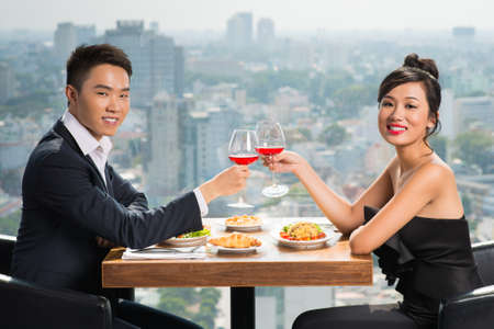 Portrait of a young adorable couple having date at a luxury restaurant