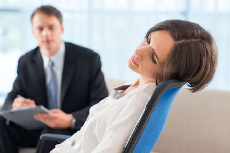 deeply: Close-up image of a deeply frustrated patient at psychotherapy session