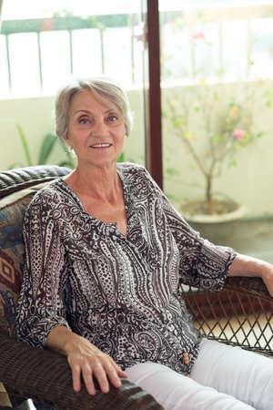 Portrait of a senior woman in an armchair
