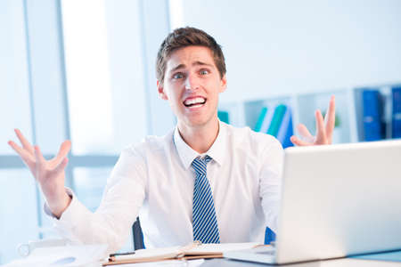Shocked and stressed businessman Stock Photo