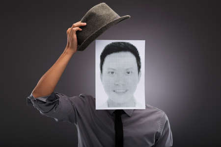 Man with head covered by a digital portrait Stock Photo