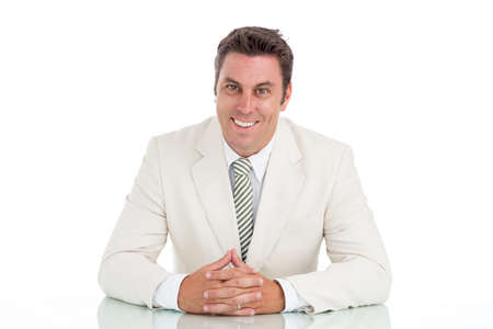 Portrait of cheerful businessman sitting at the table