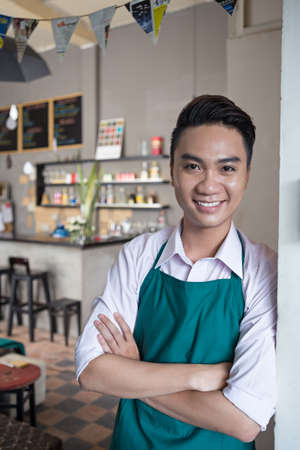 Portrait of cheerful cafe owner Stock Photo