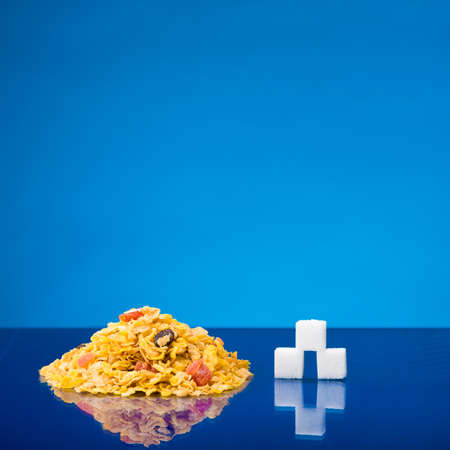 Still life showing amount of sugar in a portion of cereals