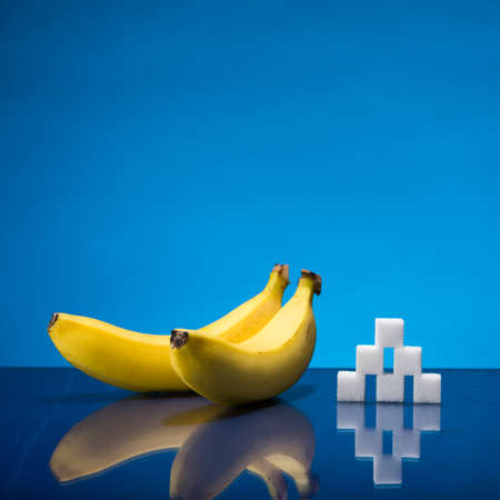 Still life showing amount of sugar in two bananas