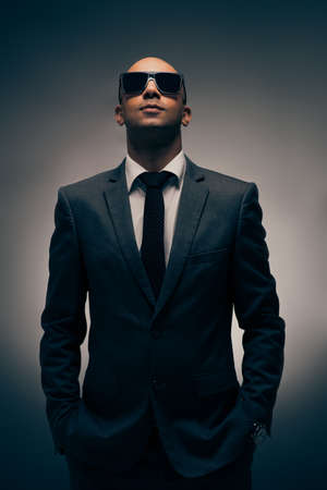 Portrait of confident businessman wearing sunglasses Stock Photo