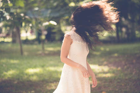 flicking: Woman flicking her hair outdoors