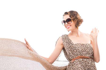 Attractive woman in leopard fluttering dress
