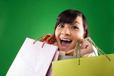 Close-up portrait of crazy female shopaholic Stock Photo