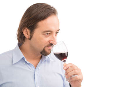 Middle-aged male sommelier tasting red wine Stock Photo