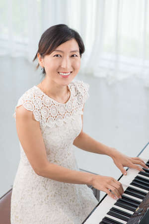Portrait of elegant Korean female musician Stock Photo