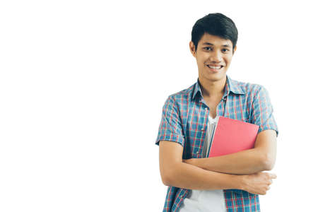 Portrait of handsome Asian male student holding a book Stock Photo