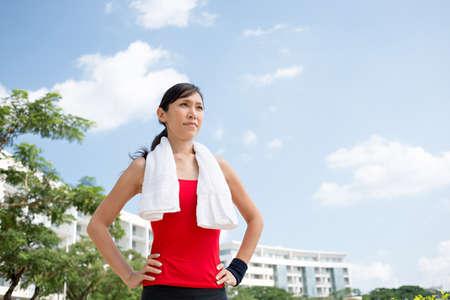 Portrait of pretty determined Vietnamese jogger