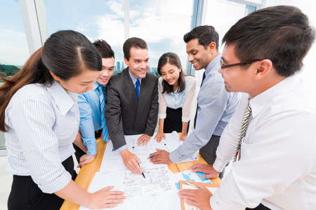 teambuilding: Colleagues discussing new business ideas Stock Photo