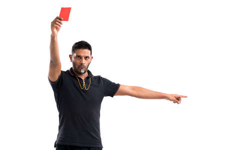 Portrait of referee whistling and showing red card