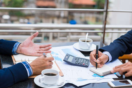 Cropped image of business people analyzing financial documents Archivio Fotografico