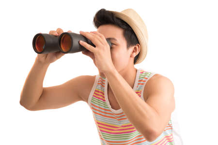 Portrait of man looking through binoculars
