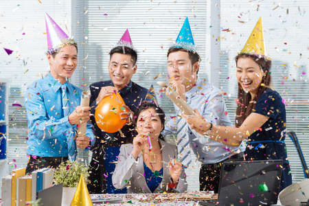 Vietnamese coworkers having celebration in the office