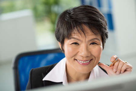 Close-up of smiling face of businesswoman