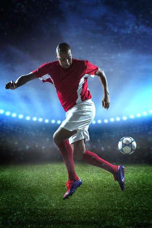Full-length portrait of soccer player dribbling in match