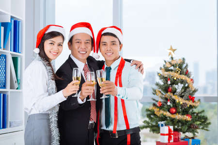 Asian business team celebrating Christmas in the office