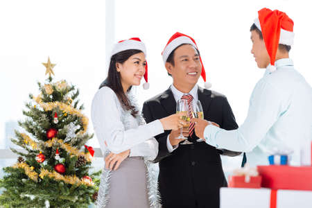Asian office workers celebrating Christmas