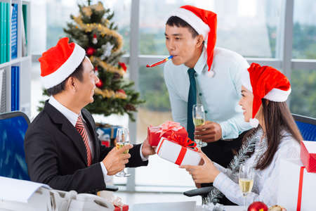 Asian coworkers having celebration of  Christmas in the office Stock Photo