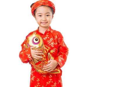 koi: Happy Asian girl with toy brocaded carp
