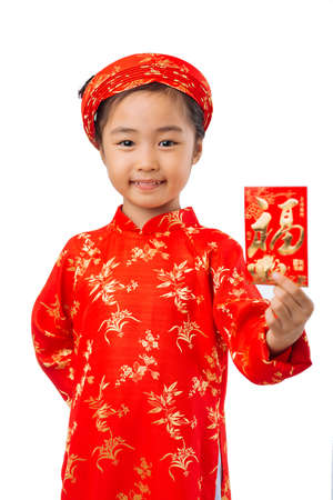 Girl in traditional Vietnamese dress showing greeting card, focus on child Stock Photo