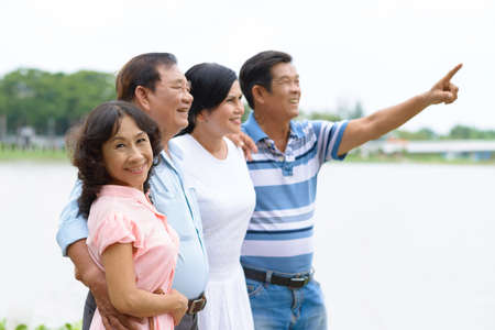 couples outdoors: Two happy Asian senior couples outdoors Stock Photo