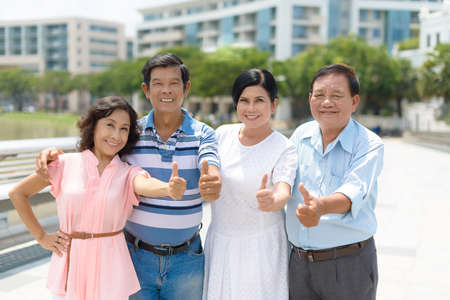 Group of Vietnamese senior people showing thumbs-up Stock Photo - 73168161