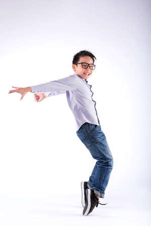 Cheerful young dancer performing freeze move on his toes Stock Photo