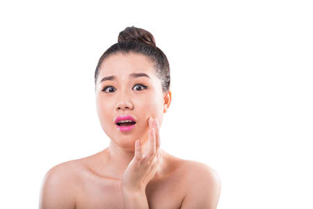 Shocked woman found a pimple or wrinkle on her perfect skin