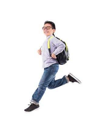 Happy boy with backpack running to school