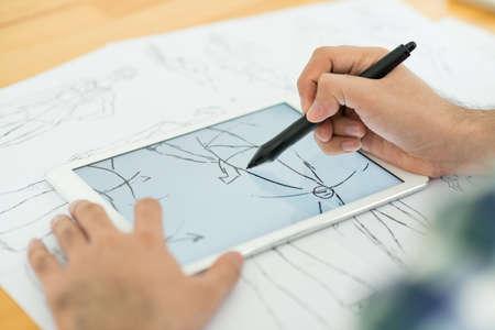 Fashion designer drawing sketch on the digital tablet