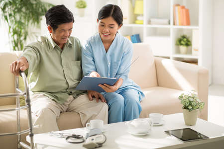 Young doctor explaining medical prescription to aged patient