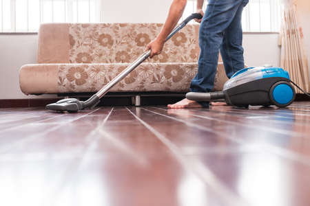 Cropped Image Of Man Vacuuming Wooden Floor Stock Photo Picture And