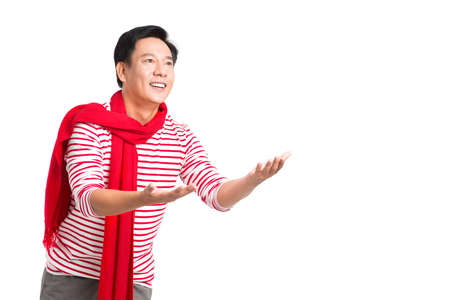 Smiling Asian man trying to catch something, isolated on white Stock Photo