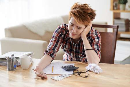 Young accountant having problem with striking balance 版權商用圖片