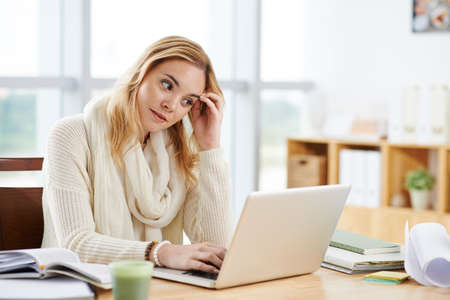 Young female copywriter suffering from writers block
