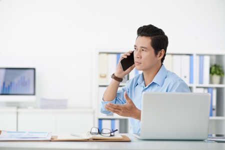 telephone call: Businessman talking on the phone to his chief Stock Photo
