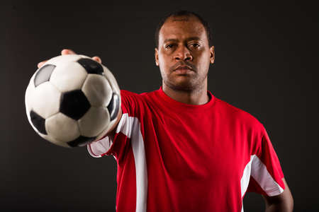 Portrait of a Decisive soccer player with a ball Stock Photo