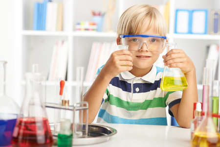 diligent: Schoolchild working with chemical reagents in the class Stock Photo