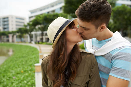 Young couple in love tenderly kissing outdoors Stock Photo