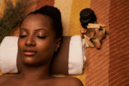 Close-up image of African-American woman with beautiful glowing skin enjoying spa treatment Stock Photo